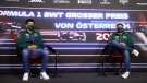 Aston Martin drivers Lance Stroll, left, and Sebastian Vettel attend a media conference in Spielberg, Austria, on Juy 1, 2021. (Clive Rose / Pool Photo via AP)