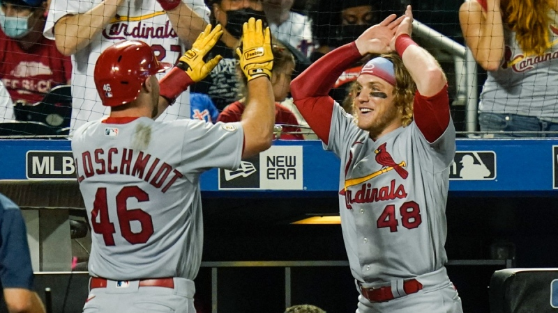 St. Louis Cardinals' Harrison Bader (48) celebrates with Paul Goldschmidt (46) after Goldschmidt hit a home run during the seventh inning against the New York Mets, on Sept. 15, 2021. (Frank Franklin II  AP)