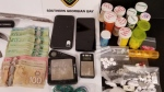 OPP seize a quantity of Cocaine, Oxycodone pills, cash and other drug paraphernalia from a Midland motel room on Sept., 14, 2021. (OPP/ Supplied)