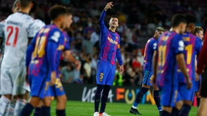 Barcelona's Gerard Pique reacts at the end of a Champions League group E soccer loss to Bayern at Camp Nou stadium in Barcelona, Spain, on Sept. 14, 2021. (Joan Monfort / AP)