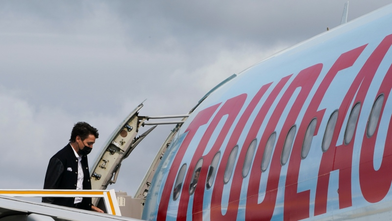Liberal leader Justin Trudeau boards his campaign plane after a stop in Halifax, N.S., on Wednesday, Sept. 15, 2021. THE CANADIAN PRESS/Sean Kilpatrick
