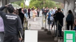 People lineup at a COVID-19 testing clinic Wednesday, Sept. 15, 2021 in Montreal. THE CANADIAN PRESS/Ryan Remiorz