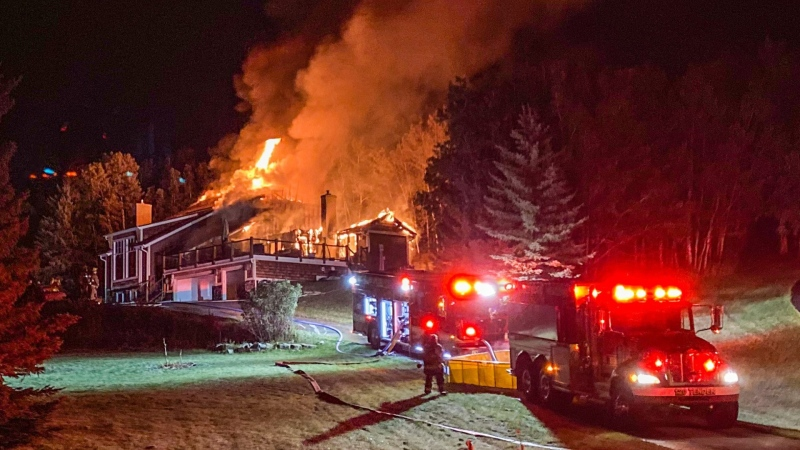 A home west of Bragg Creek engulfed in flames early Thursday morning. (viewer photo)