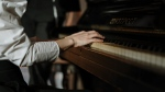 A person plays a piano in this file photo. (cottonbro / Pexels)