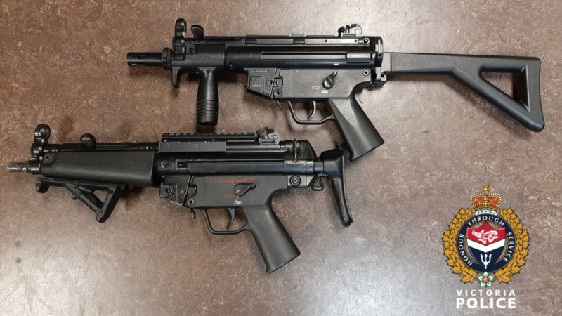 """The """"realistic"""" replica firearm (top) is shown beside a real firearm (bottom): (Victoria Police)"""