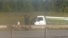 Police attend the scene after a dump truck rolled onto its side on Highway 11 north of Barrie, Ont., on Thurs., Sept. 16, 2021 (Rob Cooper/CTV News)