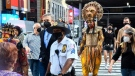 Costumed cast members of Broadway's 'The Lion King,' L. Steven Taylor, as Mufasa, right, and and Tshidi Manye, as Rafiki, left, appear in New York's Times Square, Sept. 14, 2021. (Marc A. Hermann / Metropolitan Transportation Authority via AP)