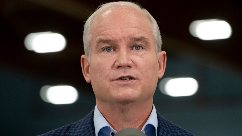Conservative leader Erin O'Toole responds to questions during a campaign stop at a curling rink Thursday, September 16, 2021 in Saint John, N.B. THE CANADIAN PRESS/Adrian Wyld