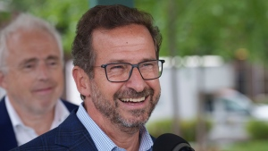 Bloc Quebecois leader Yves-Francois Blanchet laughs during a news conference in Longueuil, Que. on Wednesday, September 15, 2021. THE CANADIAN PRESS/Paul Chiasson