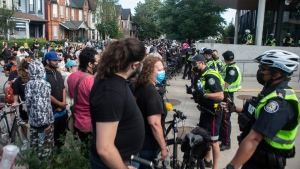 Encampment supporters gather outside Toronto Police's 14 Division to demand the release of colleagues who were detained as police and city workers cleared the Lamport Stadium Park homeless encampment in Toronto on Wednesday, July 21, 2021. THE CANADIAN PRESS/Chris Young