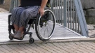 A woman in a wheelchair tries to navigate around the community. (Steve Mansbridge/CTV News)