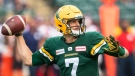Edmonton Elks quarterback Trevor Harris (7) makes the throw against the Montreal Alouettes during first half CFL action in Edmonton, Alta., on Saturday August 14, 2021. THE CANADIAN PRESS/Jason Franson.