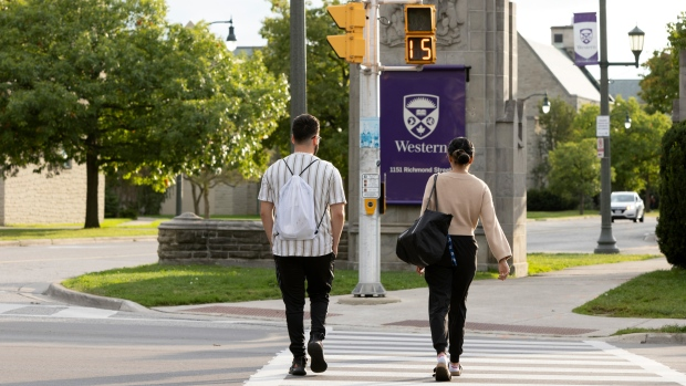 Students walk at the Western University campus in London, Ont. on Wednesday, September 15, 2021. (THE CANADIAN PRESS/Nicole Osborne)