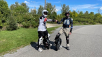 Luc Cossette and Konstantin Gamaiunov show off the electric unicycle. (Peter Szperling/CTV News Ottawa)