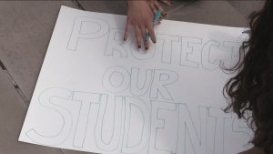 Student's at Western University in London, Ont. prepare signs ahead of Friday's planned walkout, Sept 16, 2021. (Daryl Newcombe / CTV News)