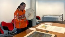 Knowledge Keeper Victor Tssessaze with a painting by Edmund Morris at the Winnipeg Art Gallery-Qaumajuq. (Supplied: WAG-Qaumajuq)