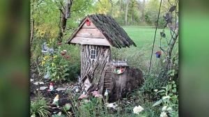 Gnome house carved out of an old tree stump. Photo by Delores Luschinski.