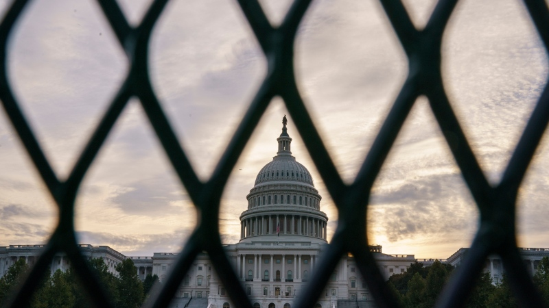 Security fencing has been reinstalled around the Capitol in Washington, Thursday, Sept. 16, 2021, ahead of a planned Sept. 18 rally by far-right supporters of former U.S. President Donald Trump who are demanding the release of rioters arrested in connection with the 6 January insurrection. (AP Photo/J. Scott Applewhite)