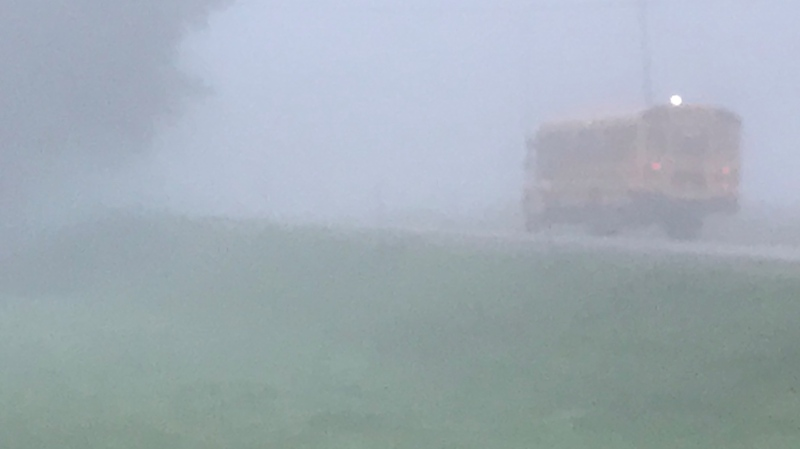 A school bus is seen driving in the fog north of London, Ont. on Friday, Sep. 17, 2021. (Sean Irvine / CTV London)