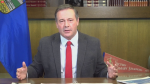 Alberta Premier Jason Kenney, appearing in front of an Alberta flag and 'Victory Calgary Stampede' pennant, says there has been a jump in demand for COVID-19 vaccine bookings in Alberta. (Facebook Live)