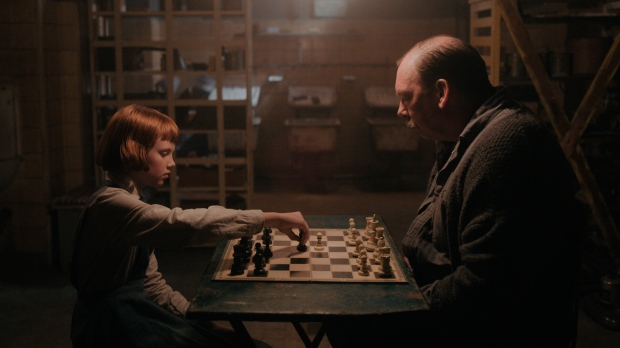 """This image released by Netflix shows Isla Johnston, left, and Bill Camp in a scene from """"The Queen's Gambit."""" (Netflix via AP)"""