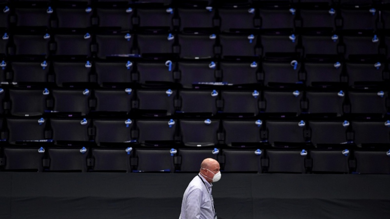 Los Angeles Clippers owner Steve Ballmer wears a mask while walking courtside, on June 12, 2021. (Keith Birmingham / The Orange County Register via AP)