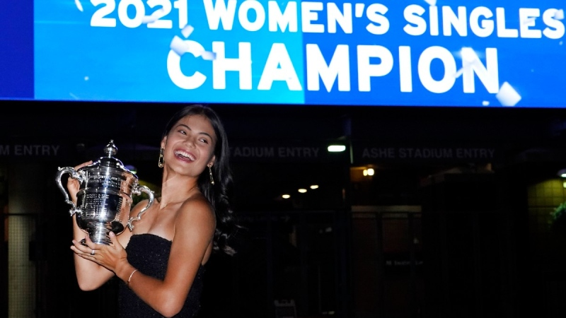 Emma Raducanu poses outside Arthur Ashe Stadium with the championship trophy after she defeated Leylah Fernandez at the US Open tennis championships, on Sept. 11, 2021. (Elise Amendola / AP)