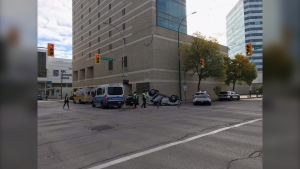 A vehicle remains overturned following a crash in downtown Winnipeg on September 17, 2021. (CTV News Photo josh Crabb)