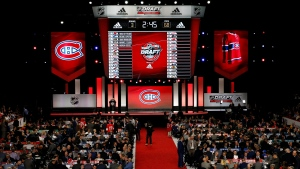 Montreal Canadiens representatives work on their third round select of the NHL hockey draft, Saturday, June 24, 2017, in Chicago. (AP Photo/Nam Y. Huh