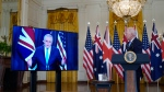U.S. President Joe Biden, listens as he is joined virtually by Australian Prime Minister Scott Morrison and British Prime Minister Boris Johnson, not seen, as he speaks about a national security initiative from the East Room of the White House in Washington, Wednesday, Sept. 15, 2021. (AP Photo/Andrew Harnik)