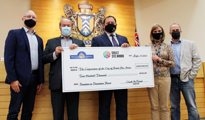 Friday morning, Sault Mayor Christian Provenzano, Coun. Sandra Hollingsworth, CAO Malcolm White and Deputy CAO Tom Vair were presented with the $200,000 donation from Clark McDaniel, CEO of Williams and McDaniel Property Management. (Supplied)