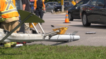 Emergency crews attend the scene of a single-car crash into a light standard on Essa Road and Mapleview Drive West in Barrie, Ont., on Fri., Sept. 17, 2021 (Steve Mansbridge/CTV News)