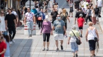 Masked pedestrians walk down Place Jacques-Cartier in Old Montreal, Sunday, July 4, 2021, as the COVID-19 pandemic continues in Canada and around the world. THE CANADIAN PRESS/Graham Hughe