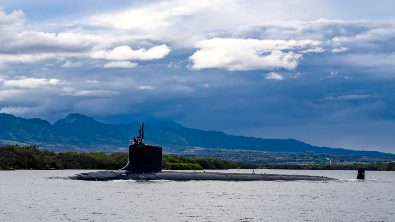 In this photo provided by U.S. Navy, the Virginia-class fast-attack submarine USS Missouri (SSN 780) departs Joint Base Pearl Harbor-Hickam for a scheduled deployment in the 7th Fleet area of responsibility, Sept. 1, 2021. (Chief Mass Communication Specialist Amanda R. Gray/U.S. Navy via AP)