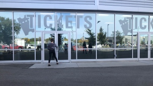 A fan enters the Saskatchewan Roughriders ticket office ahead of the first Rider game with vaccine verification. (Mackenzie Read/CTV News Regina)