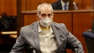 Robert Durst in his wheelchair spins in place as he looks at people in a courtroom in Inglewood, Calif., Sept. 8, 2021. (Al Seib/Los Angeles Times via AP, Pool)
