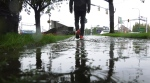 A man walks through soggy conditions in Langford, B.C. on Friday, Sept. 17, 2021. (CTV)