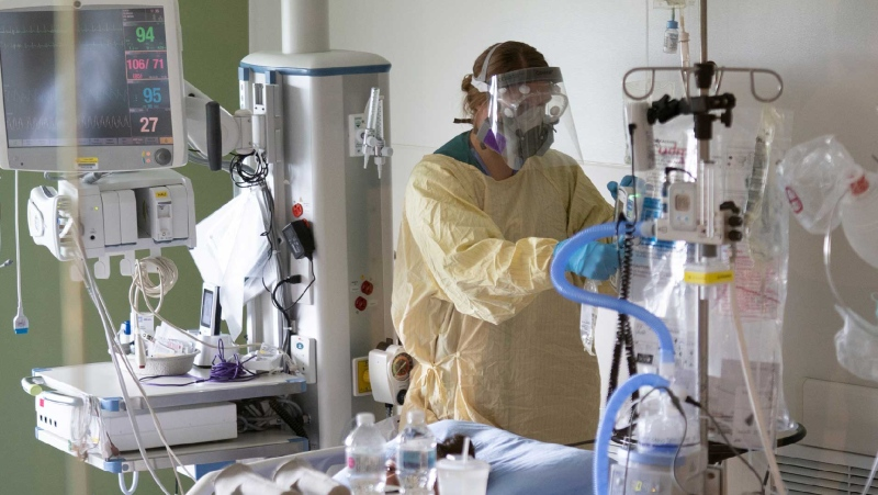 A nurse attends to a patient in the COVID-19 Intensive Care Unit at Surrey Memorial Hospital in Surrey, B.C., Friday, June 4, 2021. THE CANADIAN PRESS/Jonathan Hayward