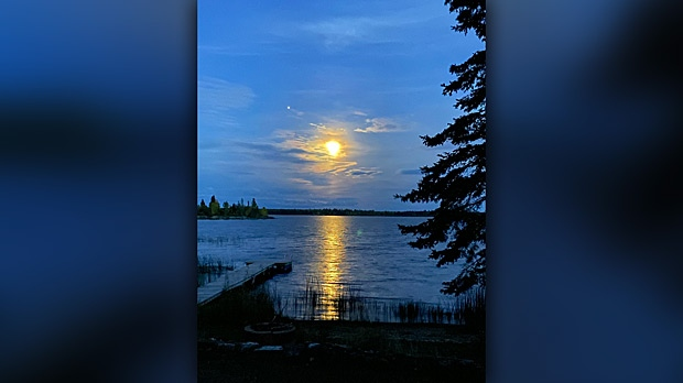 Rising moon over Rocky Lake. Photo by Jenny Keller.