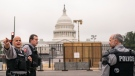 Police stand outside a security fence ahead of a rally near the U.S. Capitol in Washington, Saturday, Sept. 18, 2021. (AP Photo/Nathan Howard)