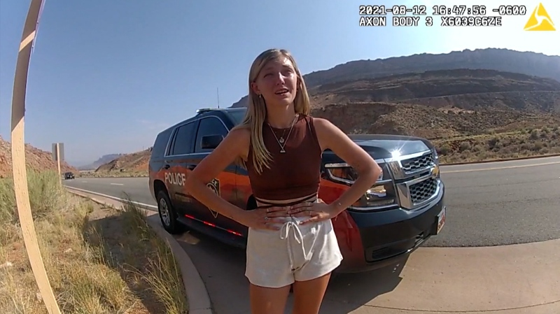 Local and federal authorities are looking for 22-year-old Gabby Petito, pictured here, talking to Moab police from bodycam footage, was reported missing by her family after she had been traveling with her boyfriend, Brian Laundrie. (Moab Police Department)
