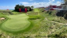 Temporary grandstands are set up around the 18th hole at Whistling Straits Golf Course, in Haven, Wis.. Tuesday, Sept. 14, 2021, in preparation for the The Ryder Cup golf matches. (Mike De Sisti/Milwaukee Journal-Sentinel via AP)
