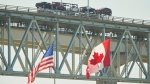 Trucks cross the Bluewater Bridge between Sarnia, Ont., and Port Huron, Mich., Sunday, Aug. 15, 2021. (THE CANADIAN PRESS / Geoff Robins)