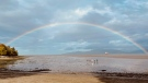 A rainbow could be seen over Spanish Banks beach in Vancouver on Saturday morning. (CTV)