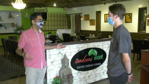 Tandoori Mint restaurant owner Guru Singh speaks with Sam Cowan (right) of the Downtown Brockville BIA.