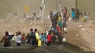 A dust storm moves across the area as Haitian migrants use a dam to cross into the United States from Mexico, Saturday, Sept. 18, 2021, in Del Rio, Texas. (AP Photo/Eric Gay)