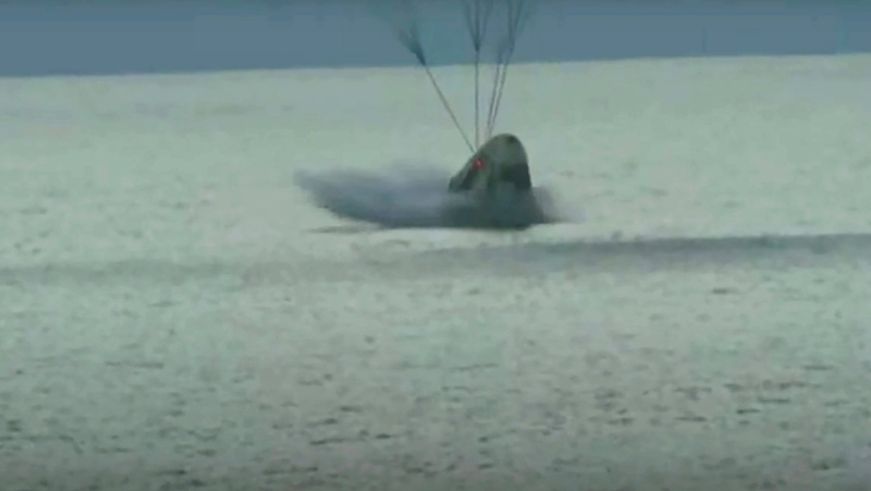 In this image taken from video a SpaceX capsule carrying four people splashes down in the Atlantic off the Florida coast, Saturday, Sept. 18, 2021. (Inspiration4 via AP)