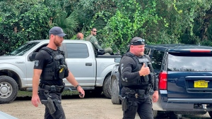 This photo provided by North Port Police Department, law enforcement officials conduct a search of the vast Carlton Reserve in the Sarasota, Fla., area for Brian Laundrie on Saturday, Sept. 18, 2021. Laundrie is a person of interest in the disappearance of his girlfriend, Gabrielle 'Gabby' Petito. (North Port Police Department via AP)