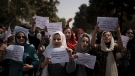 Afghan women march to demand their rights under the Taliban rule during a demonstration near the former Women's Affairs Ministry building in Kabul, Afghanistan, Sunday, Sept. 19, 2021. (AP Photo)
