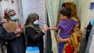 A health worker marks the finger of a child after administrating a polio vaccine in a neighbourhood of Lahore, Pakistan, Monday, Aug. 2, 2021.